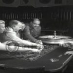Men and women bet during a roulette game in a casino in Las Vegas, Nevada. HD Stock Footage