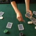 Tips for Playing Texas Holdem Hands : Dealer Button in Texas Holdem