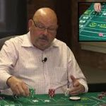 What is the procedure for tipping the craps dealers?